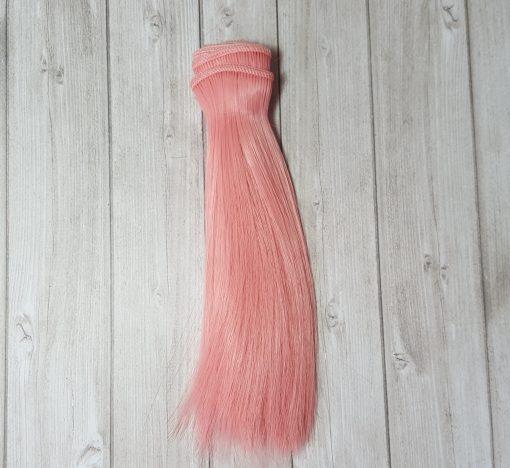 mèche de cheveux rose