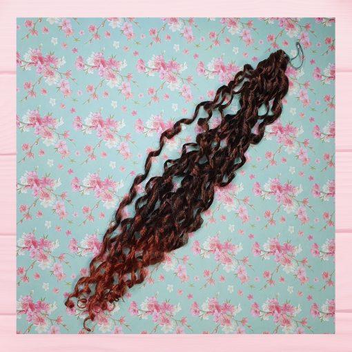 mèche cheveux auburn bouclé